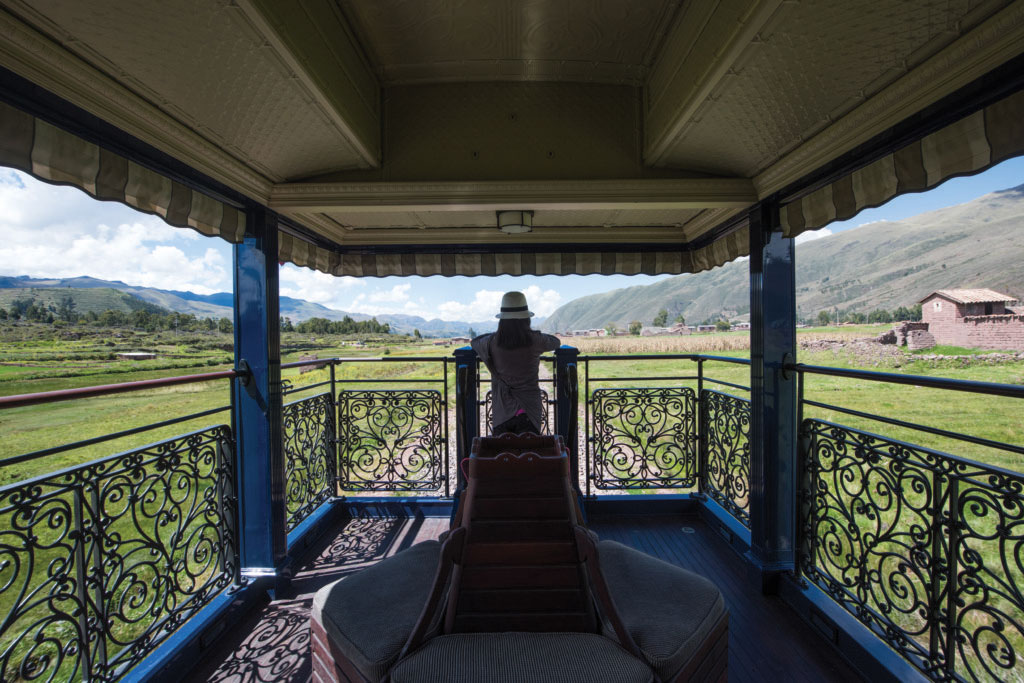 Passenger overlooking views from the Belmond Andean Explorer train