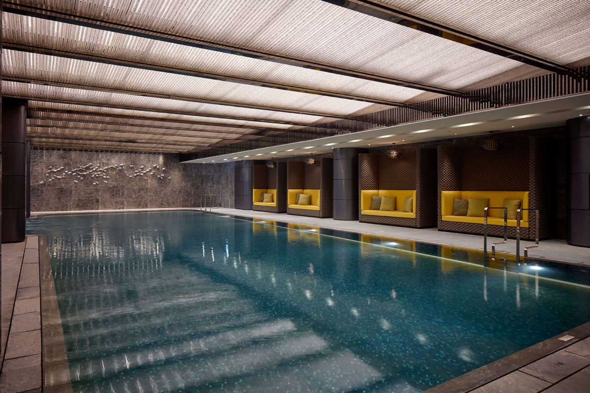 Swimming pool interior with yellow seating pods