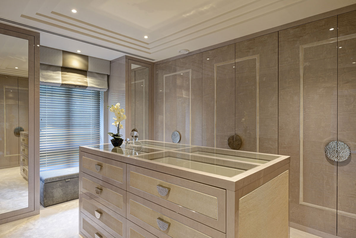 Residential design by Hill House Interiors featuring walk-in wardrobe dressing room