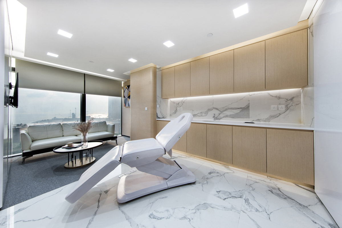 Healthcare design by GWP Architects with treatment room of the V Line Cosmetic Centre in Hong Kong