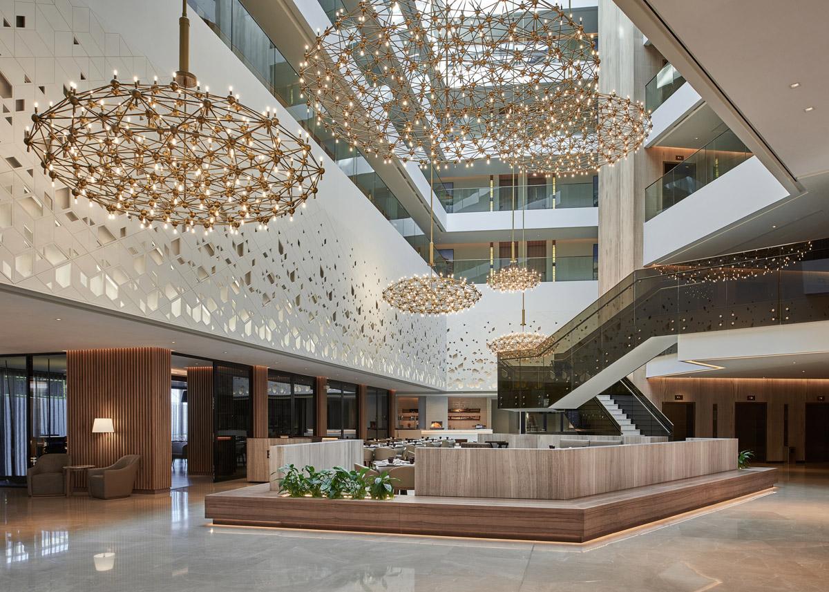 Hotel design by Godwin Austen Johnson featuring hotel lobby interior