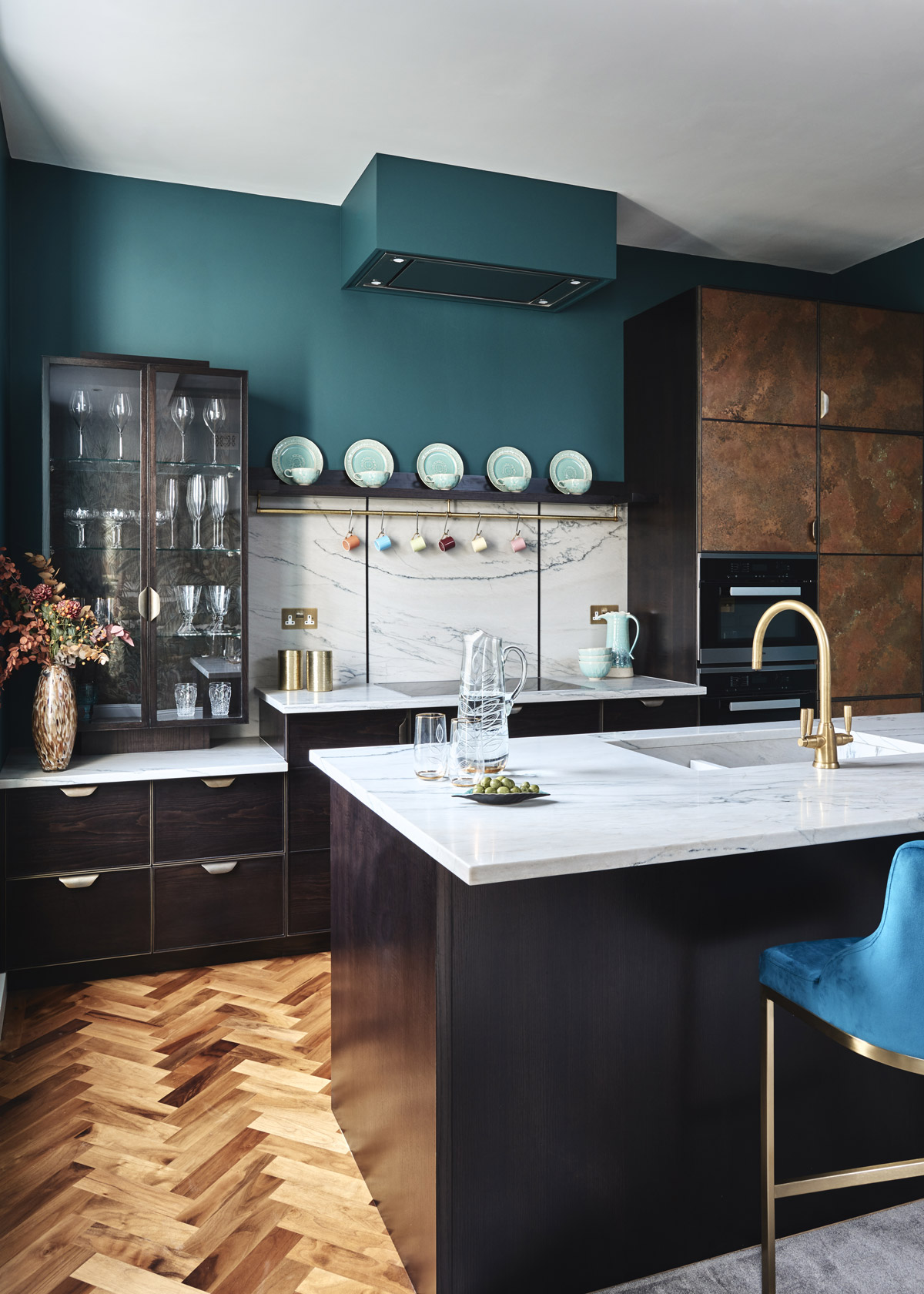 Parquet flooring defines the kitchen area in the open-plan living room.