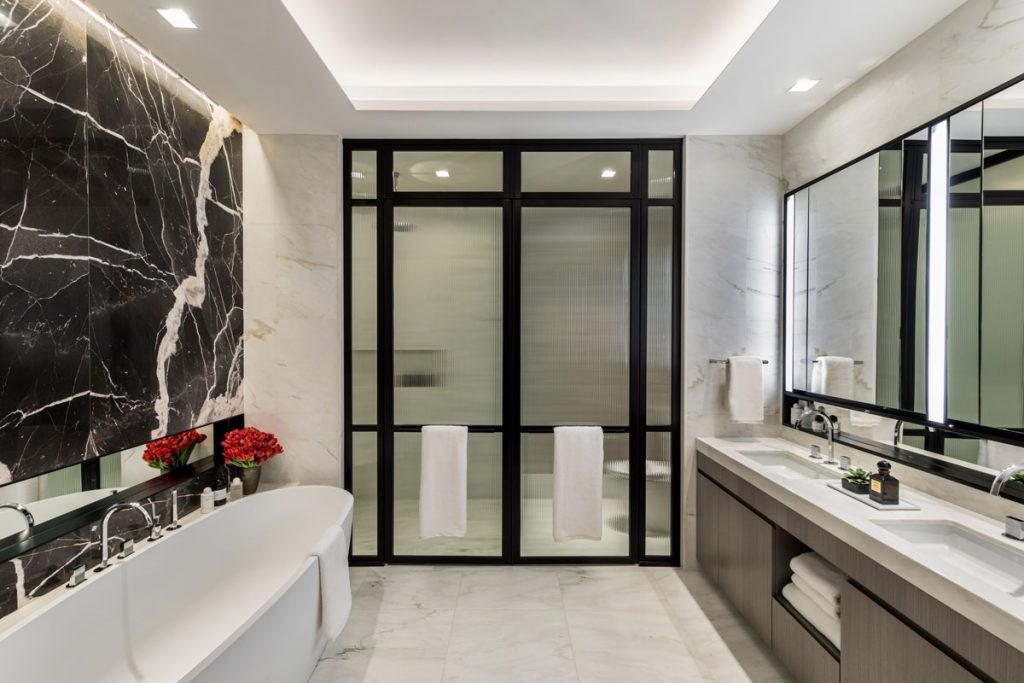 Bathroom design with black marble wall feature and double sink vanity unit