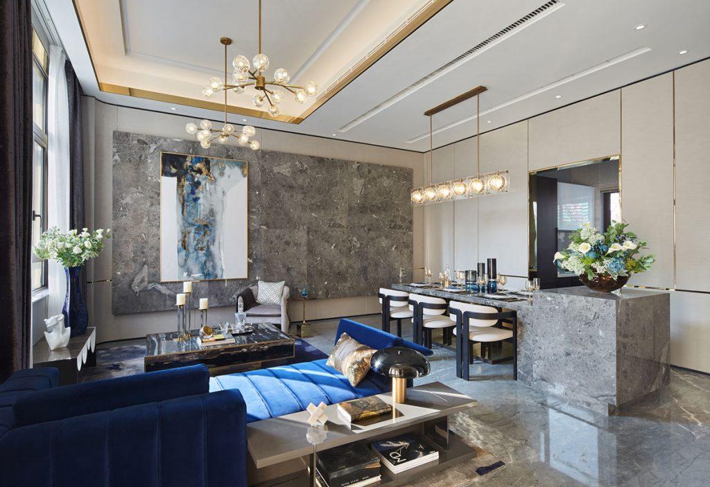 Living area interior design featuring marble flooring and blue sofa