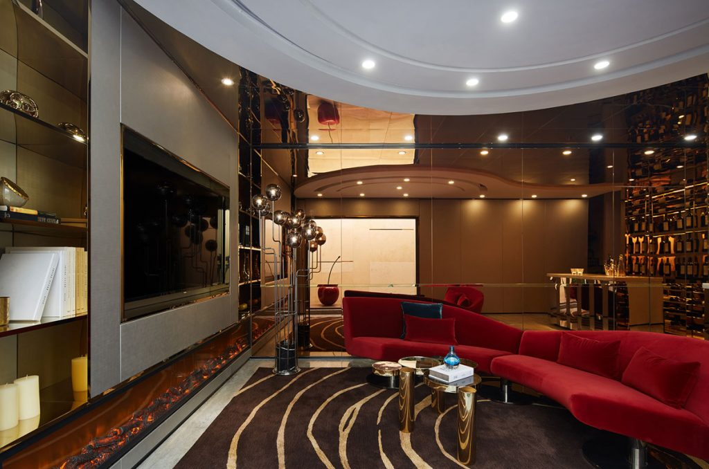 Luxury cinema room with red contemporary sofa and atmospheric lighting