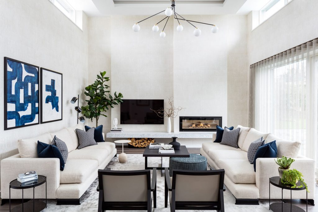 Light living room interior with abstract artwork