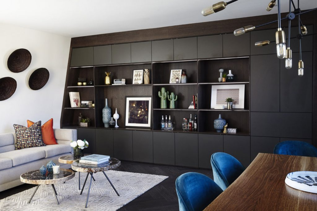 Contemporary interior design for living room with bespoke built-in shelving