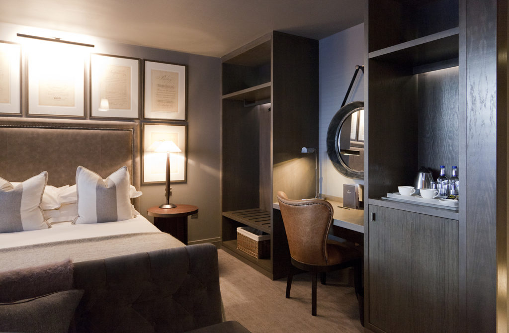Hotel design of bedroom suite interior dividing sleep and work space