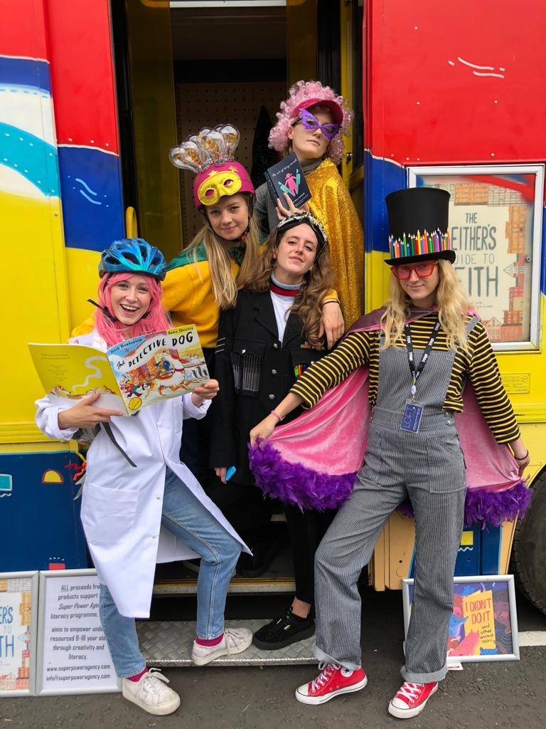Adults and children dressing up for Super Power Agency featured in how creative space can inspire children, SBID Education Council blog post by Maxine Sloss
