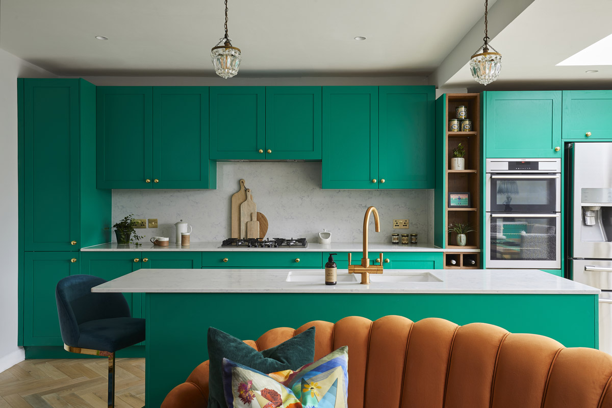 Tired Kitchen, Dining and Living Areas are United in a Bold Open Plan Space
